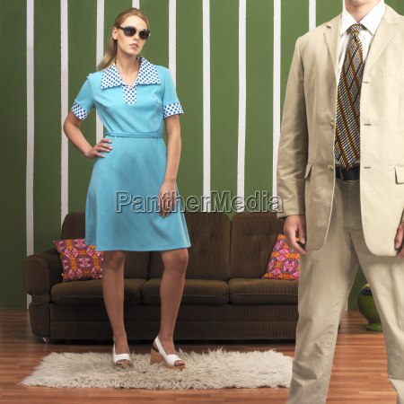 young woman and man standing in