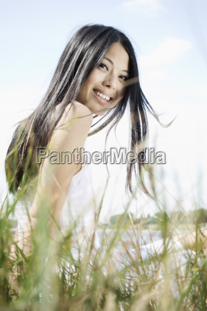 germany young woman sitting near grass