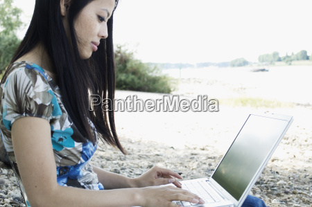 germany young woman using laptop at