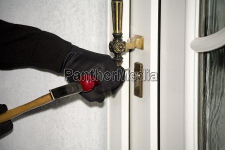 burglary hand with gloves on door