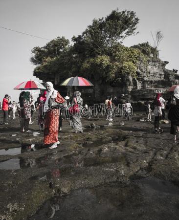 indonesia bali tourists at tanah lot