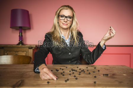 germany stuttgart businesswoman holding black pearls