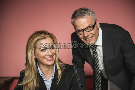 germany stuttgart businessman and woman smiling