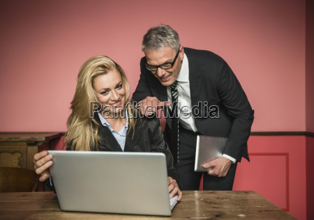 germany stuttgart businessman and woman working