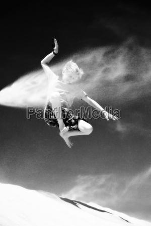 france boy jumping on sand