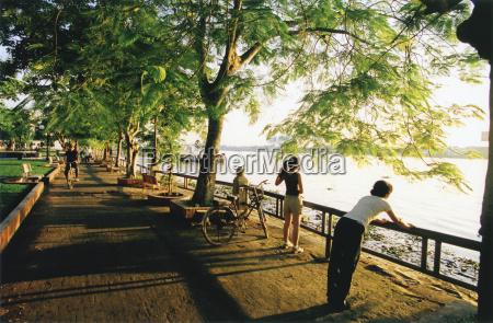 vietnam saigon persons leaning on railing