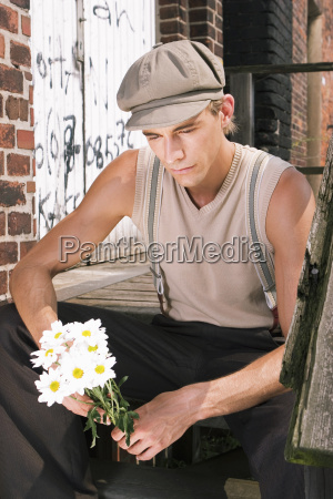 young man sitting on stair with