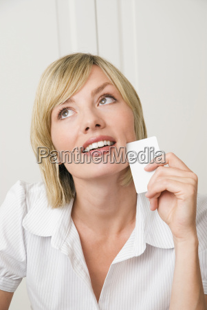 young woman holding business card portrait