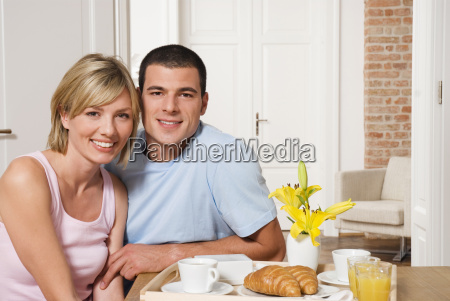 young couple having breakfast close up