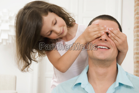 girl 8 9 covering fathers eyes