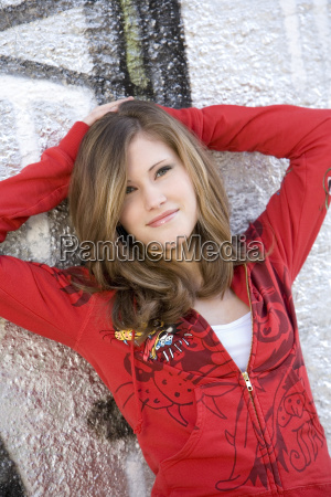 teenage girl 17 leaning on house