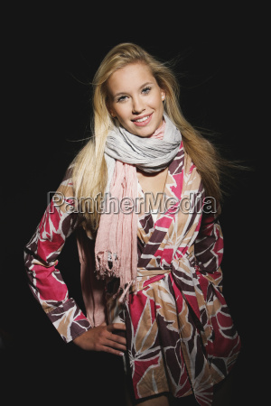young woman wearing wrap around blouse