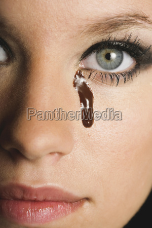 woman with melted chocolate on face