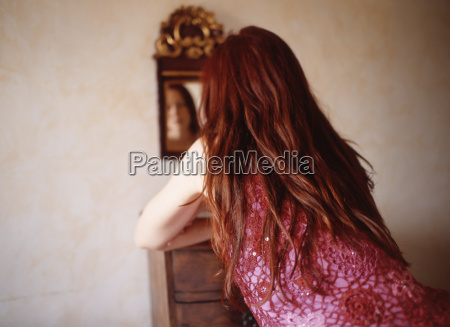 redhaired woman rear view