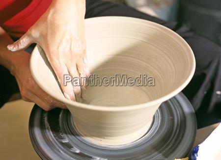 potter making a bowl