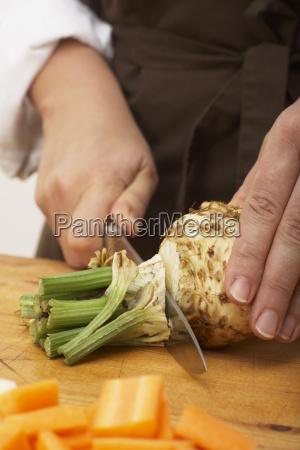 cutting celeriac close up