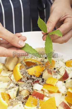 person flavouring the stuffing with bay