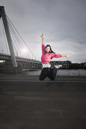 germany cologne young woman jumping portrait