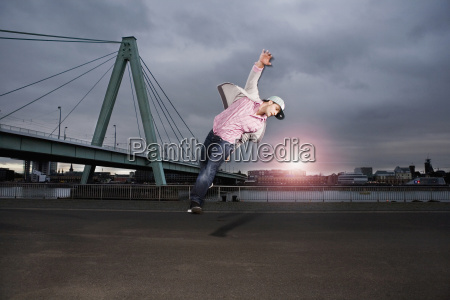 germany cologne young man jumping rhine