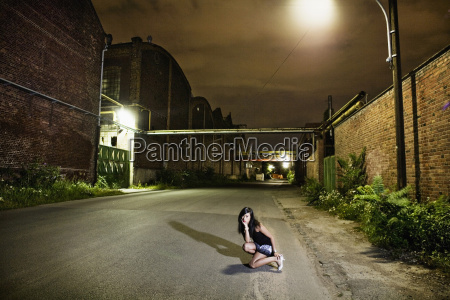 germany cologne young woman crouching on