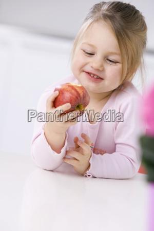 little girl 3 4 holding an