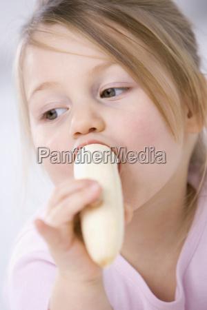 little girl 3 4 eating a