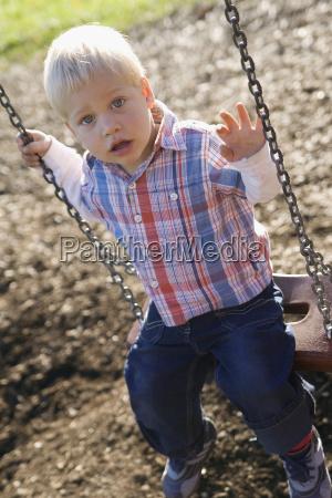 little boy 2 3 sitting on