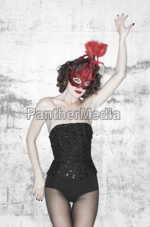 woman in lingerie wearing a mask