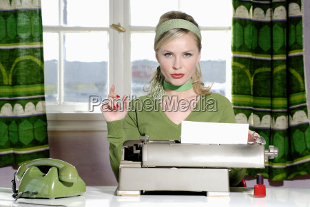 young woman sitting at desk close
