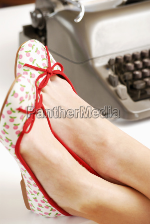 womans feet on desk close up