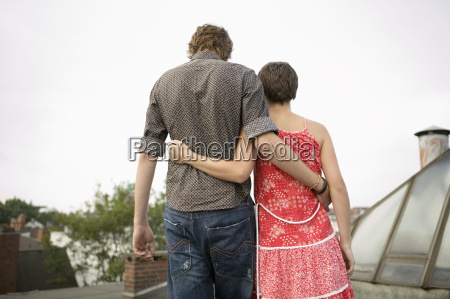 couple embracing rear view