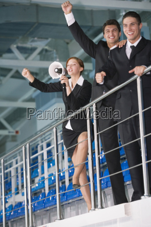 business people standing on tribune woman