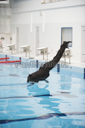 businessman jumping in pool
