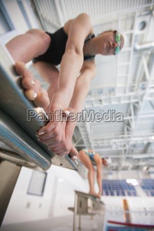 female swimmers on starting blocks
