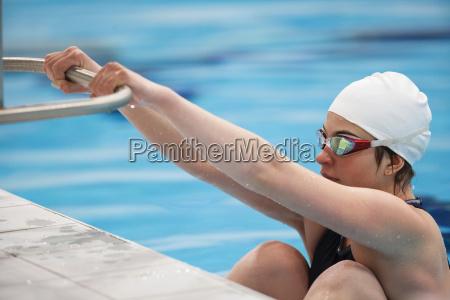 female swimmer at starting block