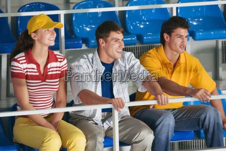 young people sitting on tribune
