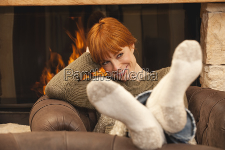 woman sitting in front of fire