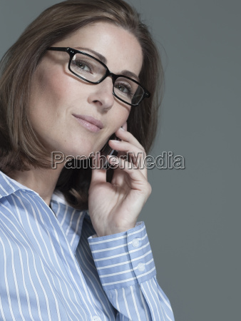 woman using mobile phone portrait close
