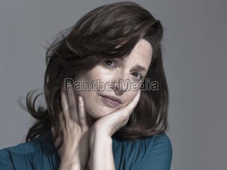 woman head in hands portrait close