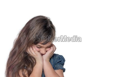 portrait of ashamed little girl isolated