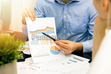 business people discussing graph and chart