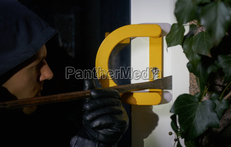 burglar trying to get into a