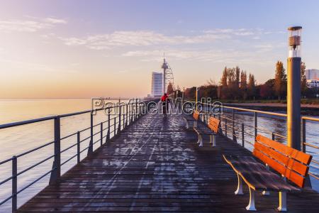 bridge in city at dawn