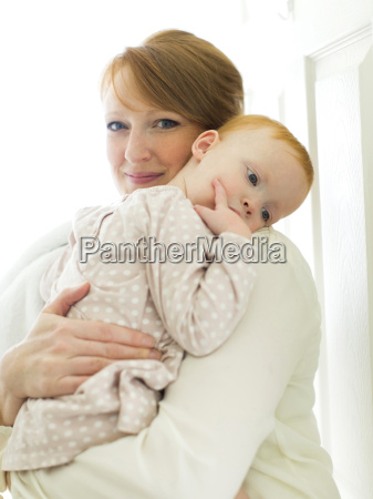 portrait of mother embracing daughter
