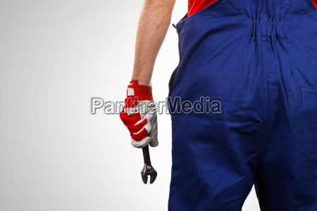 handyman with wrench in hand on