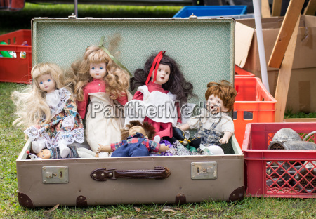 suitcase with old dolls