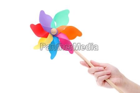 bunte spielzeug pinwheel windmuehle auf weissem