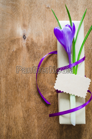 present with fresh flower and blank