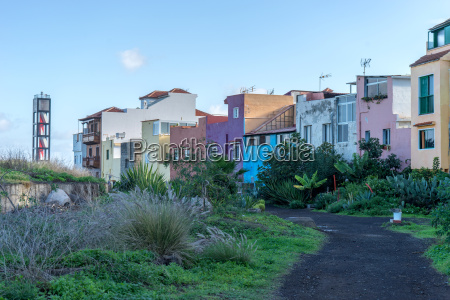 colorful houses and lighthouse in puerto