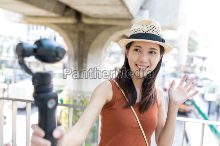 woman using video stabilizer to take